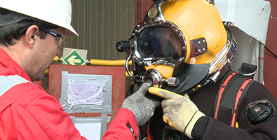 Diver in full subsea diving kit