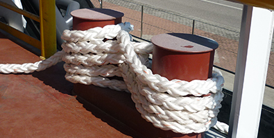 Rope wrapped around two deck mounted chocks